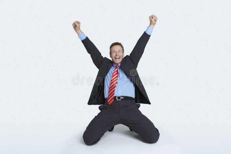 Affärsman Celebrating Victory royaltyfri bild