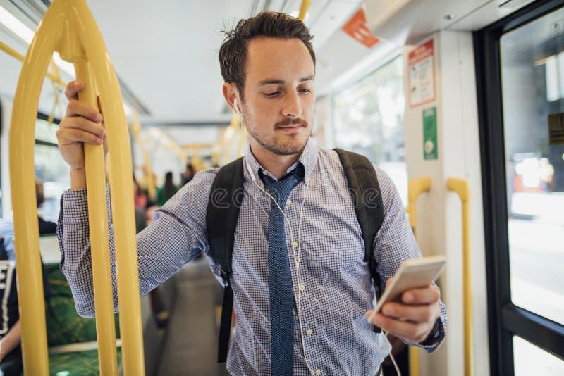Affärsman Commuting By Tram i Melbourne royaltyfria foton