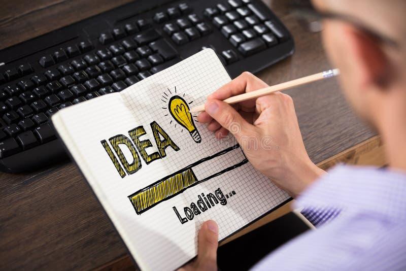 Affärsman Drawing Idea Concept i regeringsställning arkivfoton