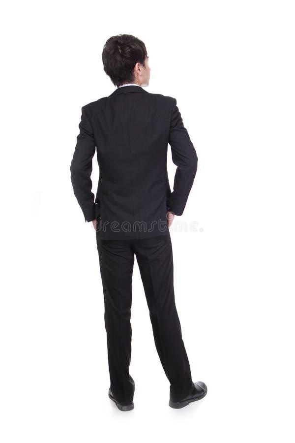 Affärsman från baksidan som ser något royaltyfri foto
