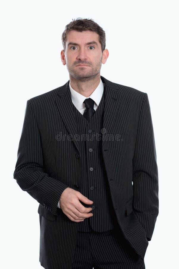 Affärsman framme av vit bakgrund royaltyfri foto