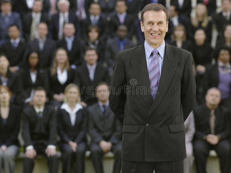 Affärsman In Front Of Multiethnic Executives arkivfoto