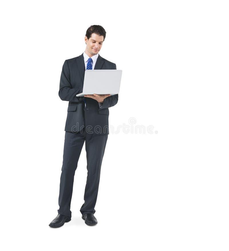 Affärsman Holding Laptop på vit bakgrund royaltyfria foton