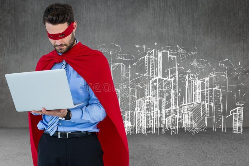 Affärsman i dräkt för toppen hjälte genom att använda bärbara datorn royaltyfri bild