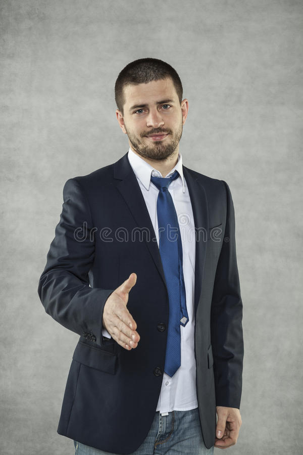 Affärsman i en dräkt, handskakning arkivbild