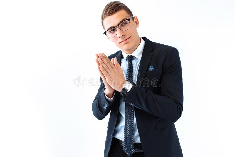 Affärsman i exponeringsglas och dräkten som gnider hans händer, listig hand arkivfoton