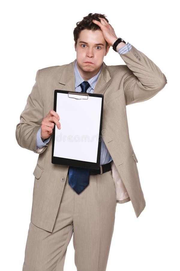 Affärsman i frustration som visar tomt papper arkivfoton