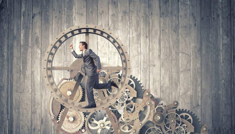 Affärsman i hjul arkivfoton