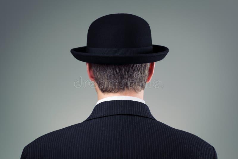 Affärsman i plommonstop arkivbild