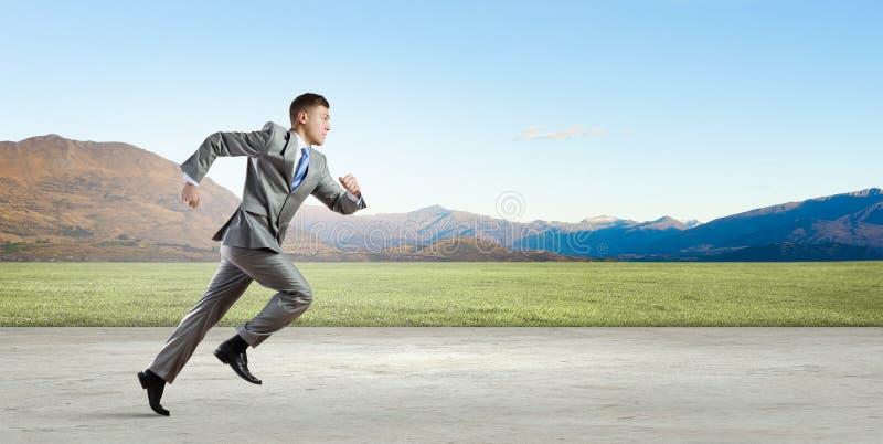 affärsman isolerad running white arkivfoto