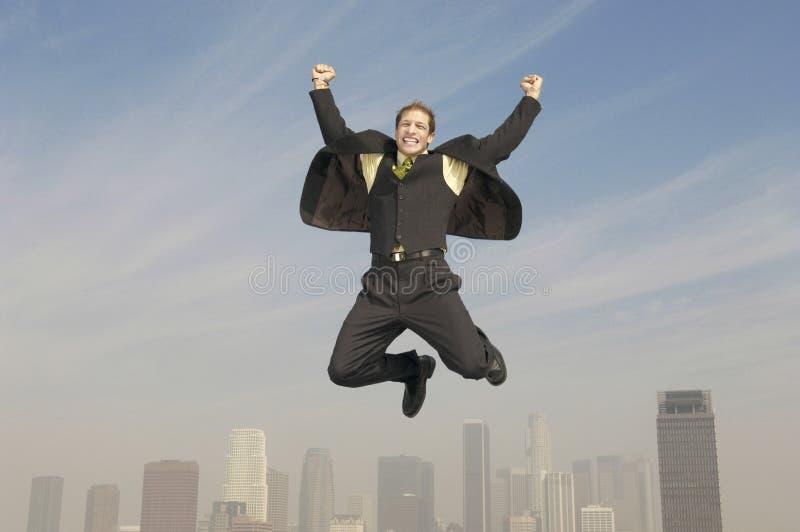Affärsman Jumping In Joy Above City arkivbild