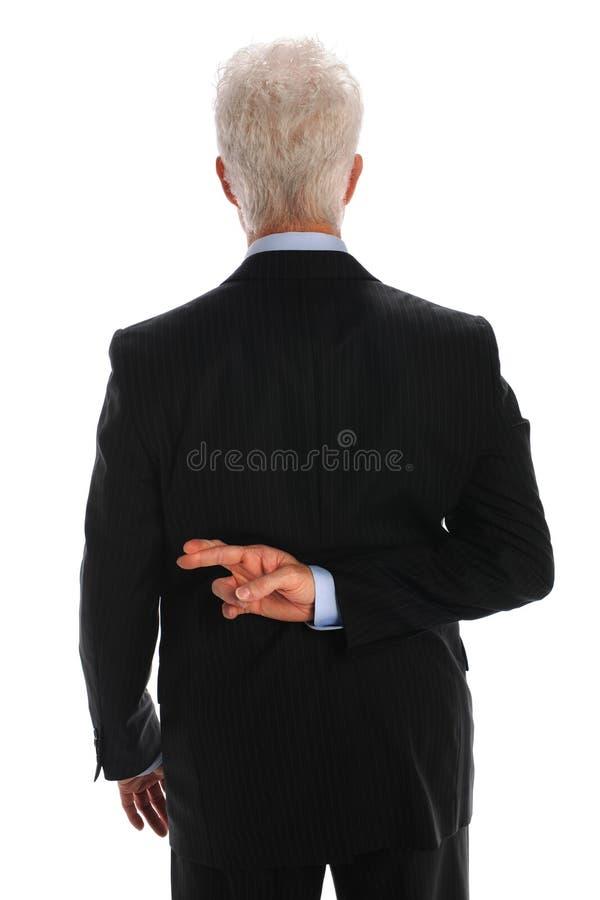 affärsman korsade fingrar arkivfoto