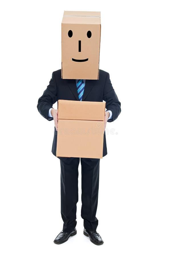 Affärsman med cardboxes arkivbild