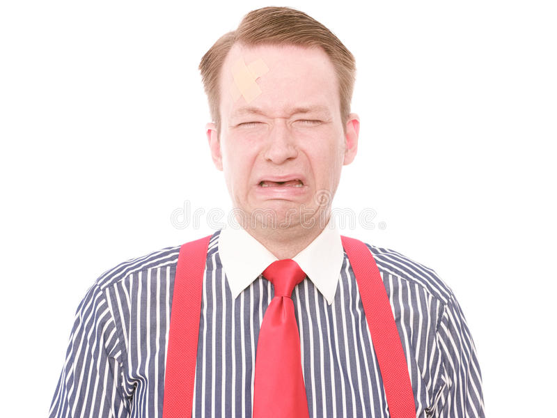 Affärsman med den mindre head skadan (som gråter version) royaltyfri foto