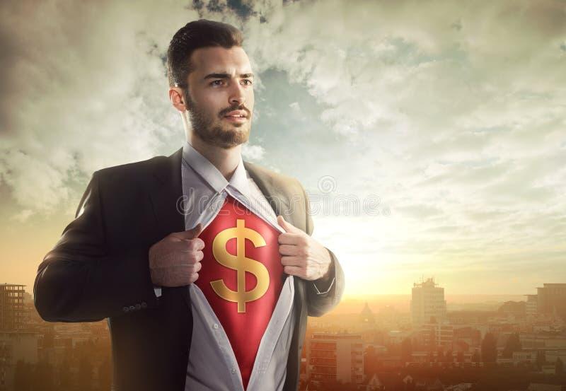 Affärsman med dollartecknet som superhero royaltyfri fotografi
