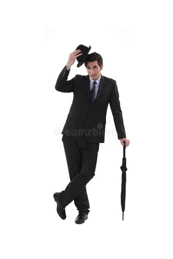 Affärsman med en hatt arkivbild