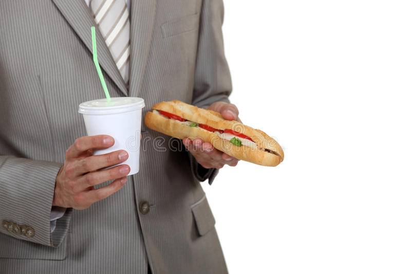 Affärsman med en smörgås royaltyfri fotografi