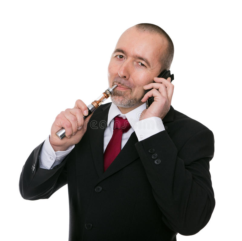 Affärsman med encigarett royaltyfri foto