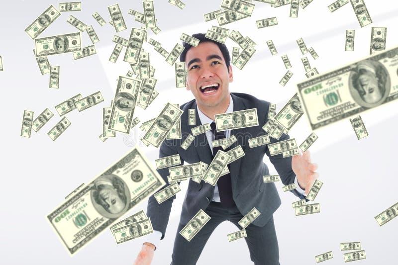 affärsman med fallande pengar fotografering för bildbyråer