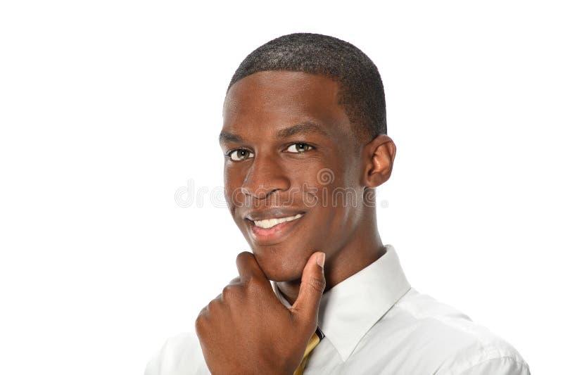 Affärsman med handen på hakan royaltyfri bild