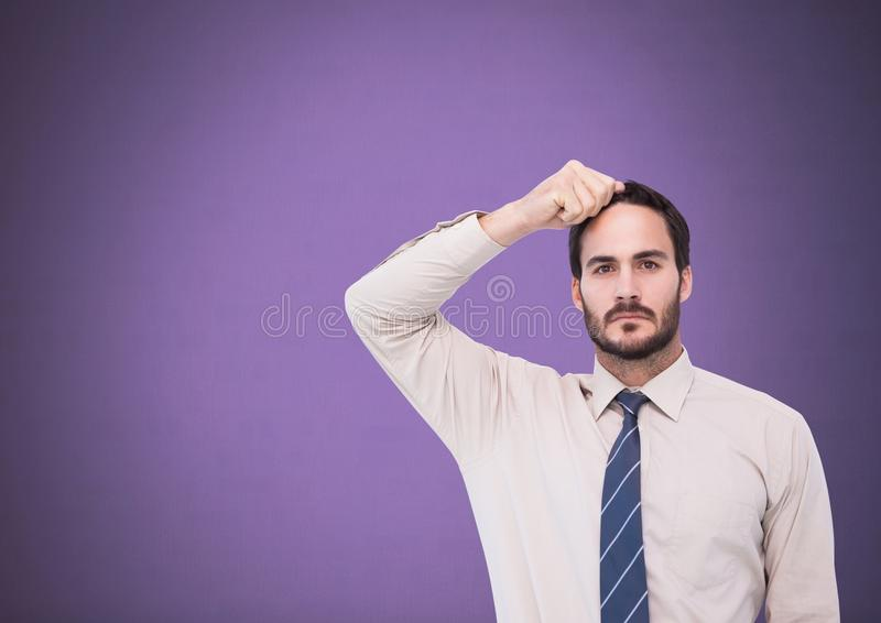 Affärsman med handen på huvudet royaltyfria foton