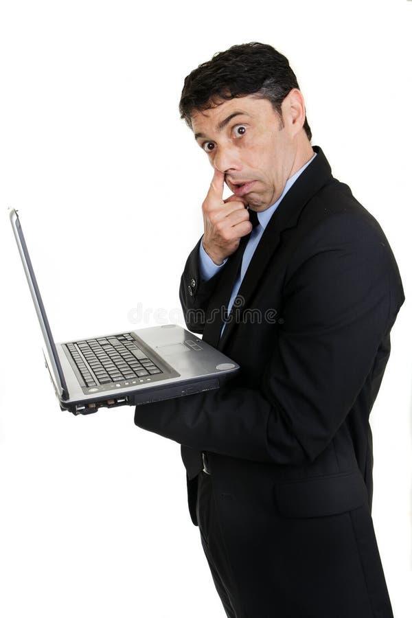 Affärsman med hans finger till hans arkivbild
