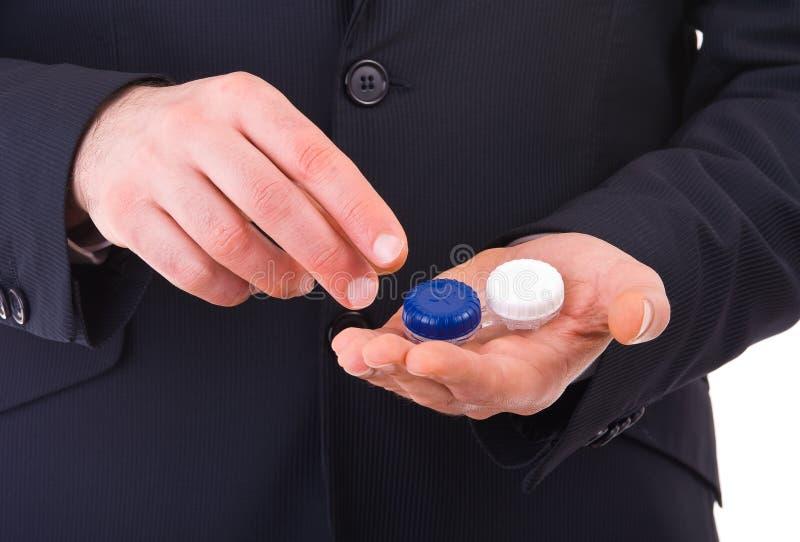 Affärsman med kontaktlinsfallet. royaltyfri fotografi