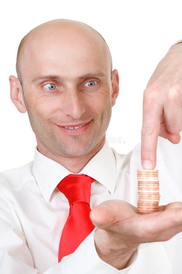 Affärsman med mynt royaltyfri foto