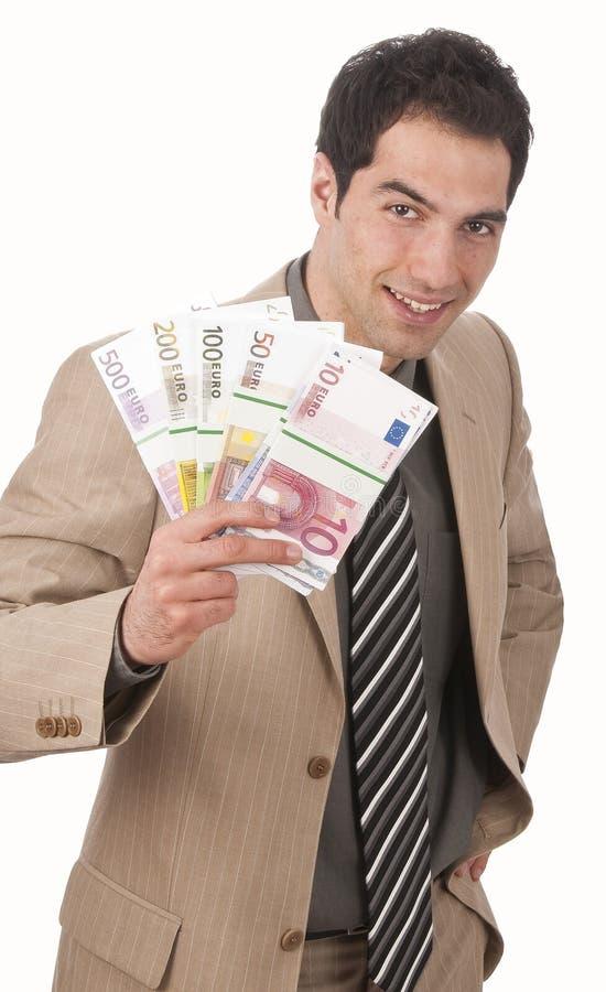 Affärsman med packen av pengar arkivfoto