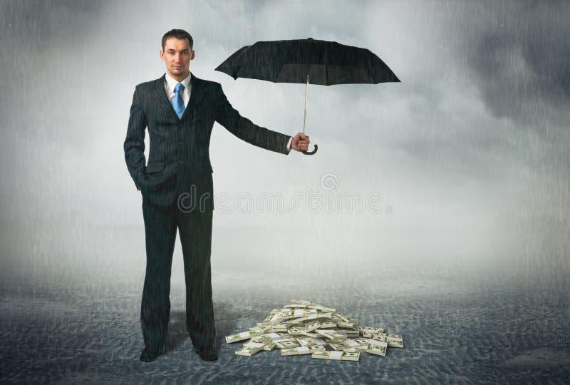 Affärsman med paraplyet royaltyfri bild