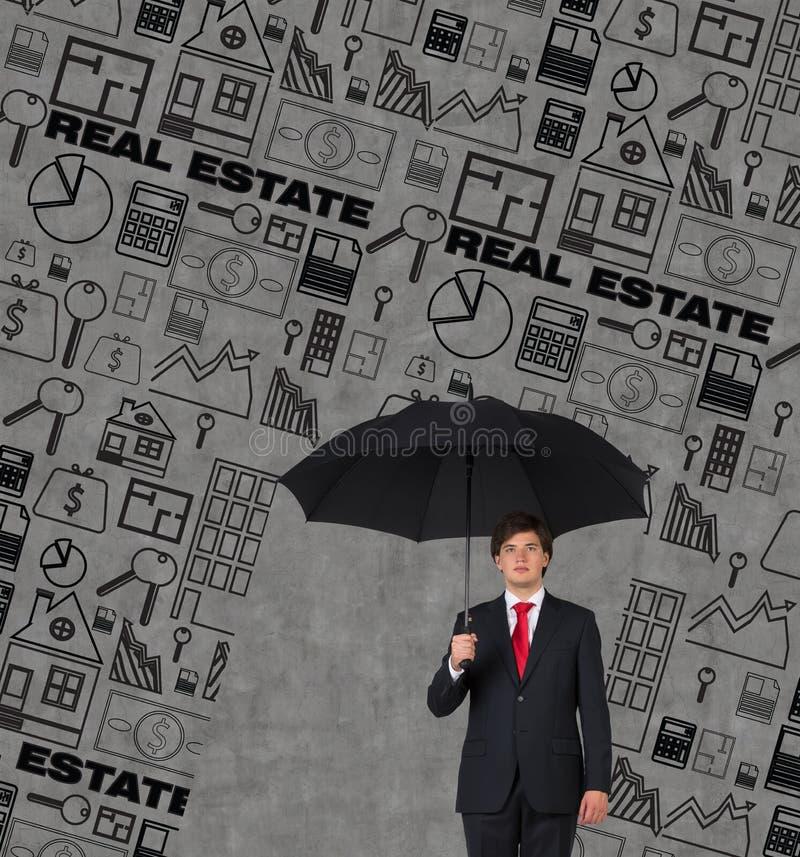 Affärsman med paraplyet arkivbilder