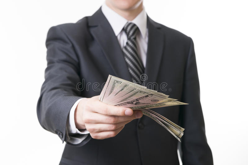 Affärsman med pengar i studio arkivbild