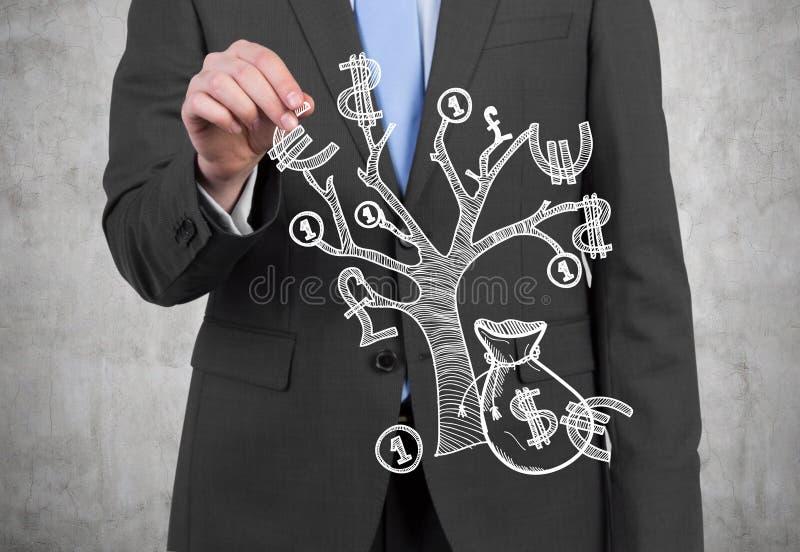 Affärsman med pengarträdet arkivfoto