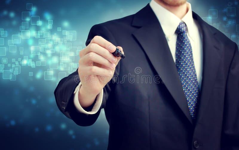 Affärsman med pennan royaltyfri foto
