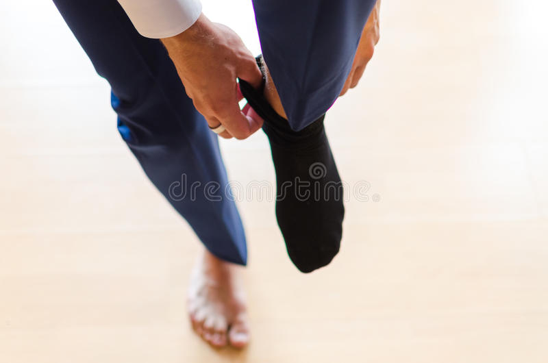 Affärsman med svarta sockor royaltyfri foto