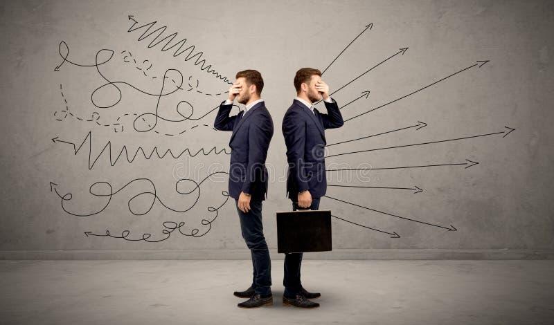 Affärsman med två val arkivfoto
