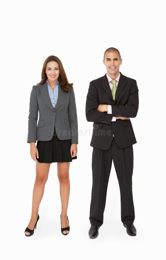 Affärsman och affärskvinna i studio royaltyfri fotografi