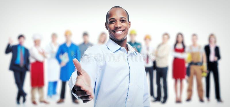 Affärsman- och arbetargrupp Lagarbete arkivfoton