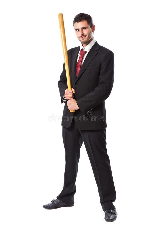Affärsman- och baseballslagträ royaltyfria bilder