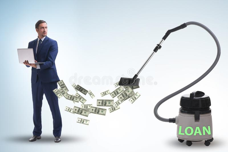 Affärsman och dammsugare som suger pengar ut ur honom royaltyfri fotografi