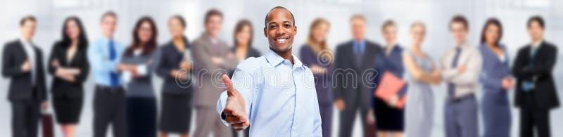 Affärsman och grupp människor royaltyfri bild