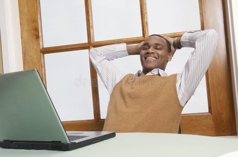 Affärsman Sitting In Chair arkivbilder