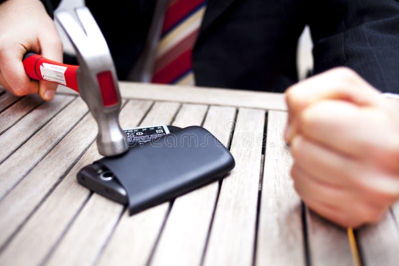 Affärsman Smashing Phone royaltyfria foton