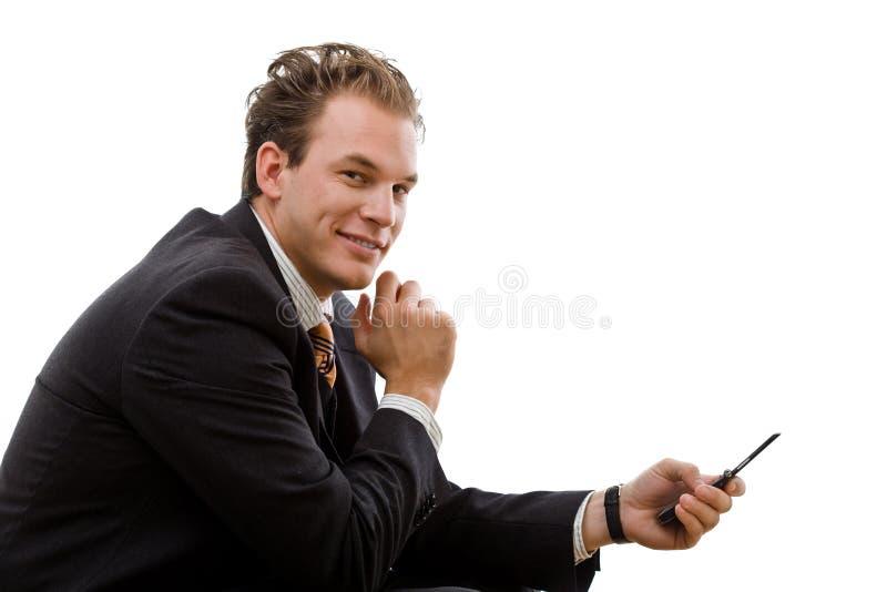 affärsman som överför sms arkivfoton