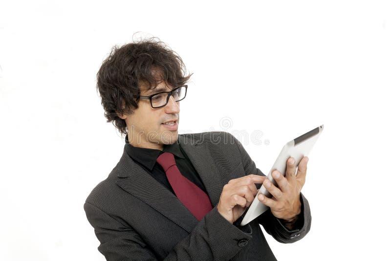 Affärsman som använder en tabletdator arkivfoton