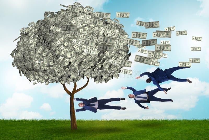 Affärsman som blåsas i väg från pengarträdet arkivfoton