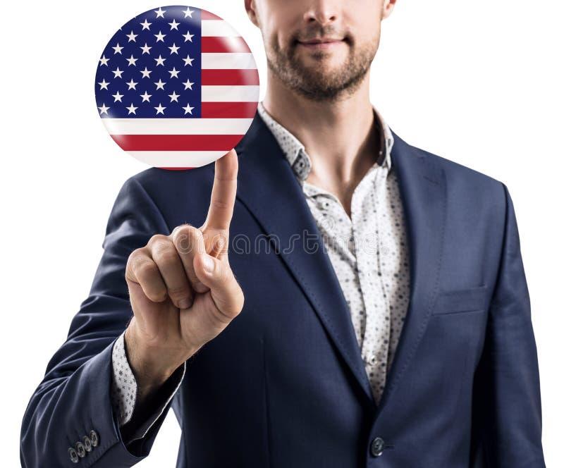 Affärsman som delar bubblan med USA flaggan arkivbild
