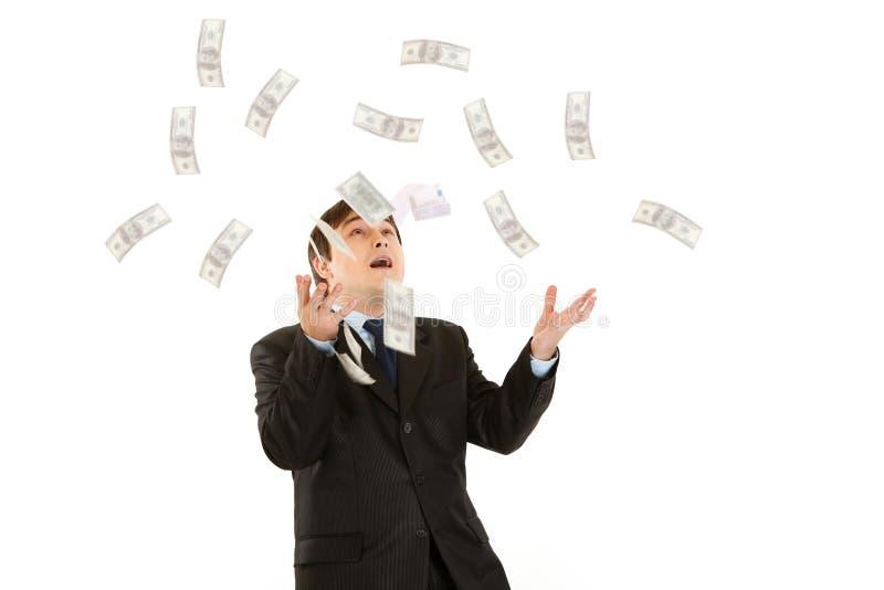 affärsman som fångar lyckliga isolerade moderna pengar fotografering för bildbyråer