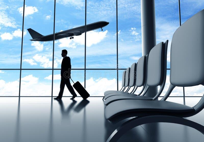Affärsman som går i flygplats royaltyfri bild