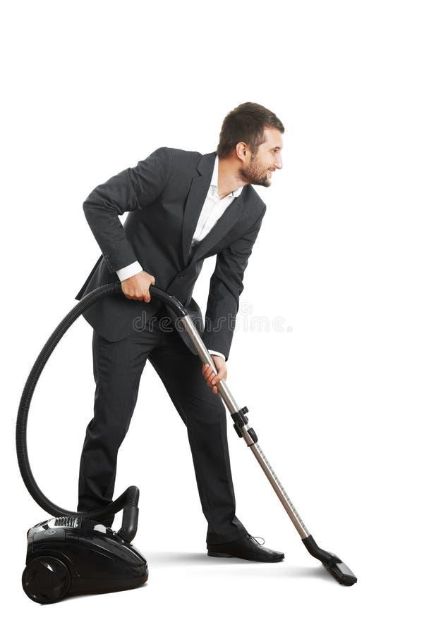 Affärsman som gör vakuumlokalvård royaltyfri foto